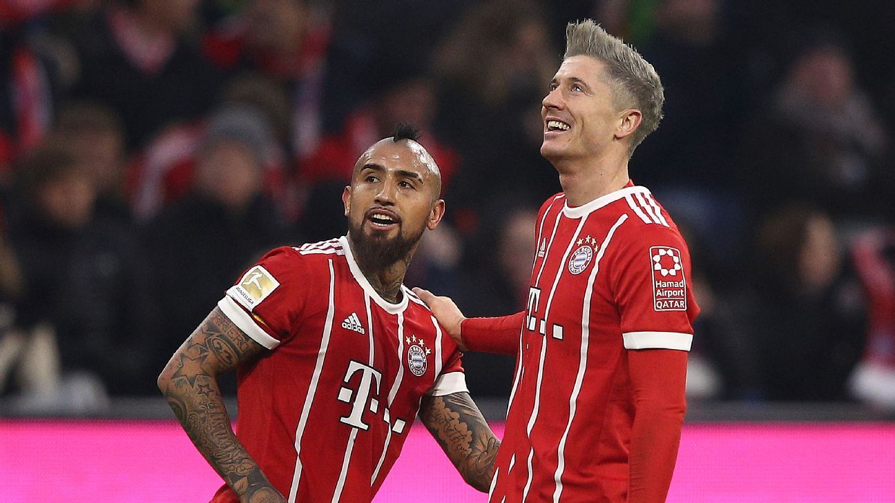 Arturo Vidal and Robert Lewandowski both scored for Bayern Munich against Augsburg.