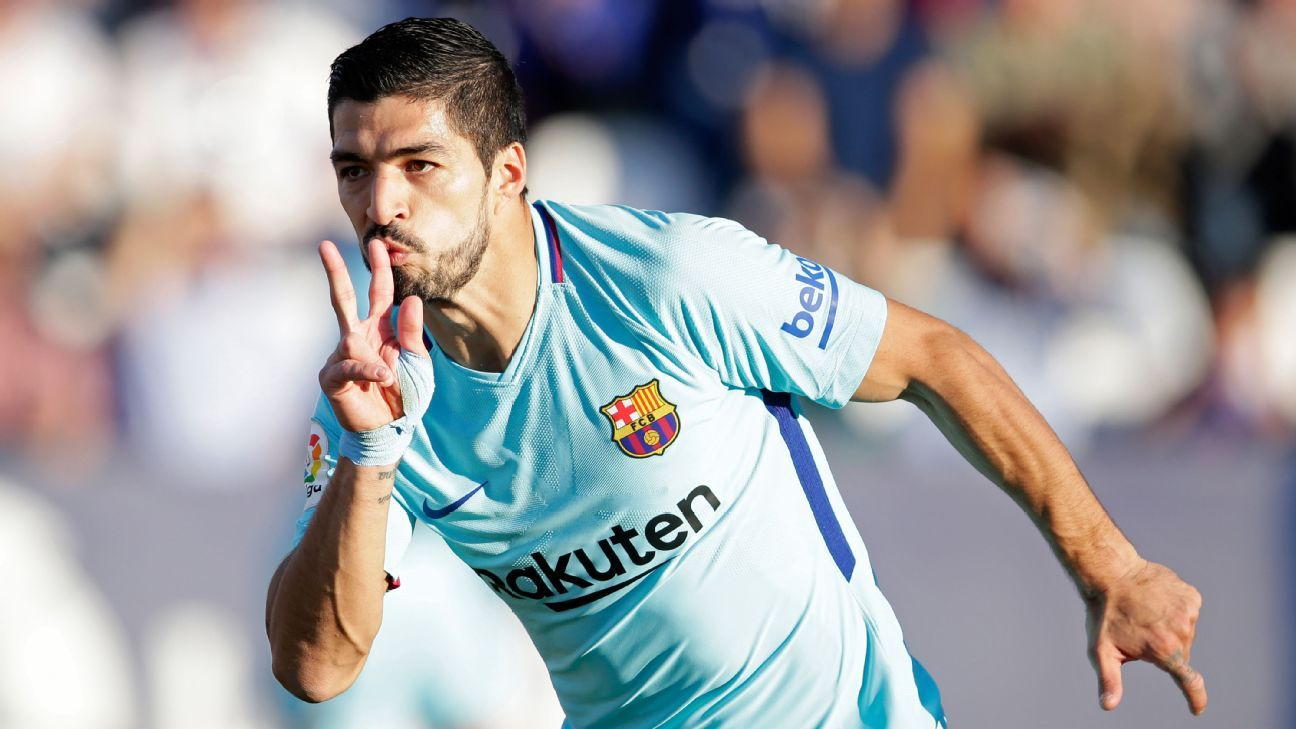 Luis Suarez celebrates after scoring his second goal in Barcelona's win against Leganes.
