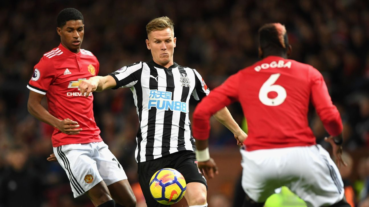 Matt Ritchie in action for Newcastle against Manchester United at Old Trafford.