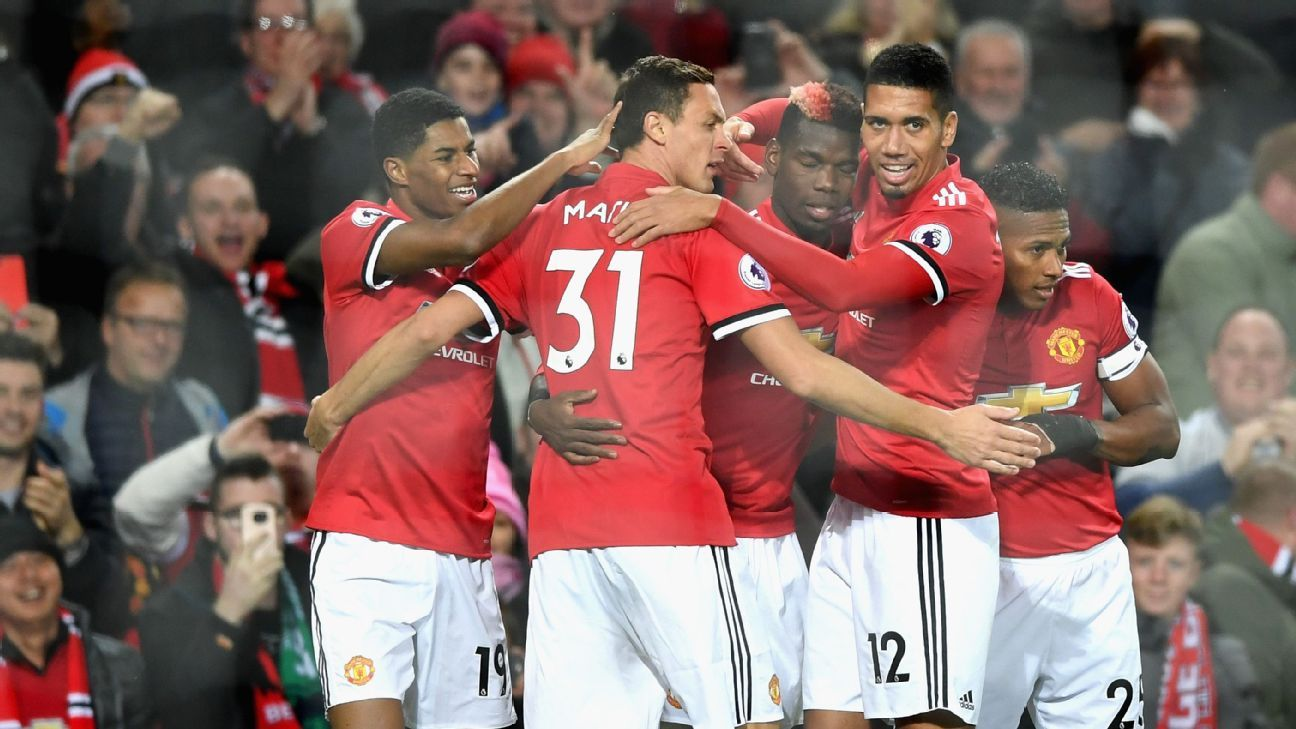 Manchester United players celebrate during their Premier League game against Newcastle.
