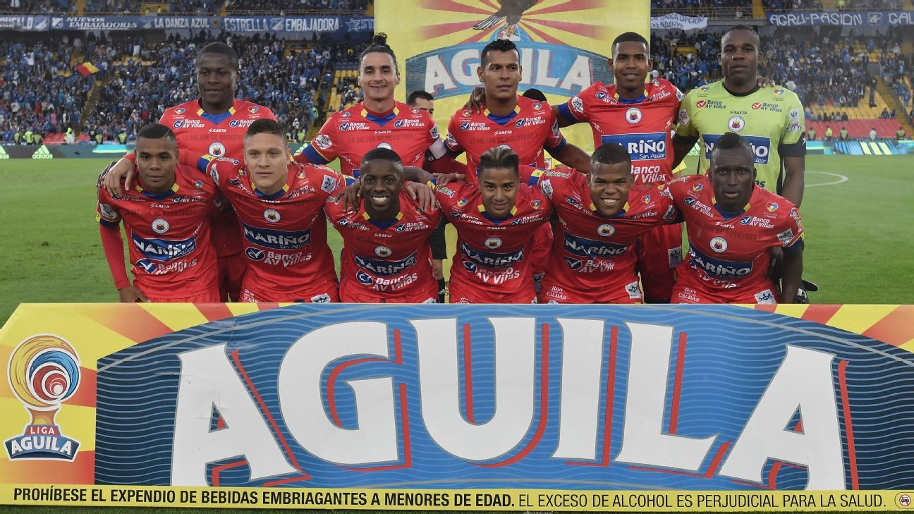 Carlos Giraldo (top row, second left) was one of those hurt when the Deportivo Pasto coach was attacked