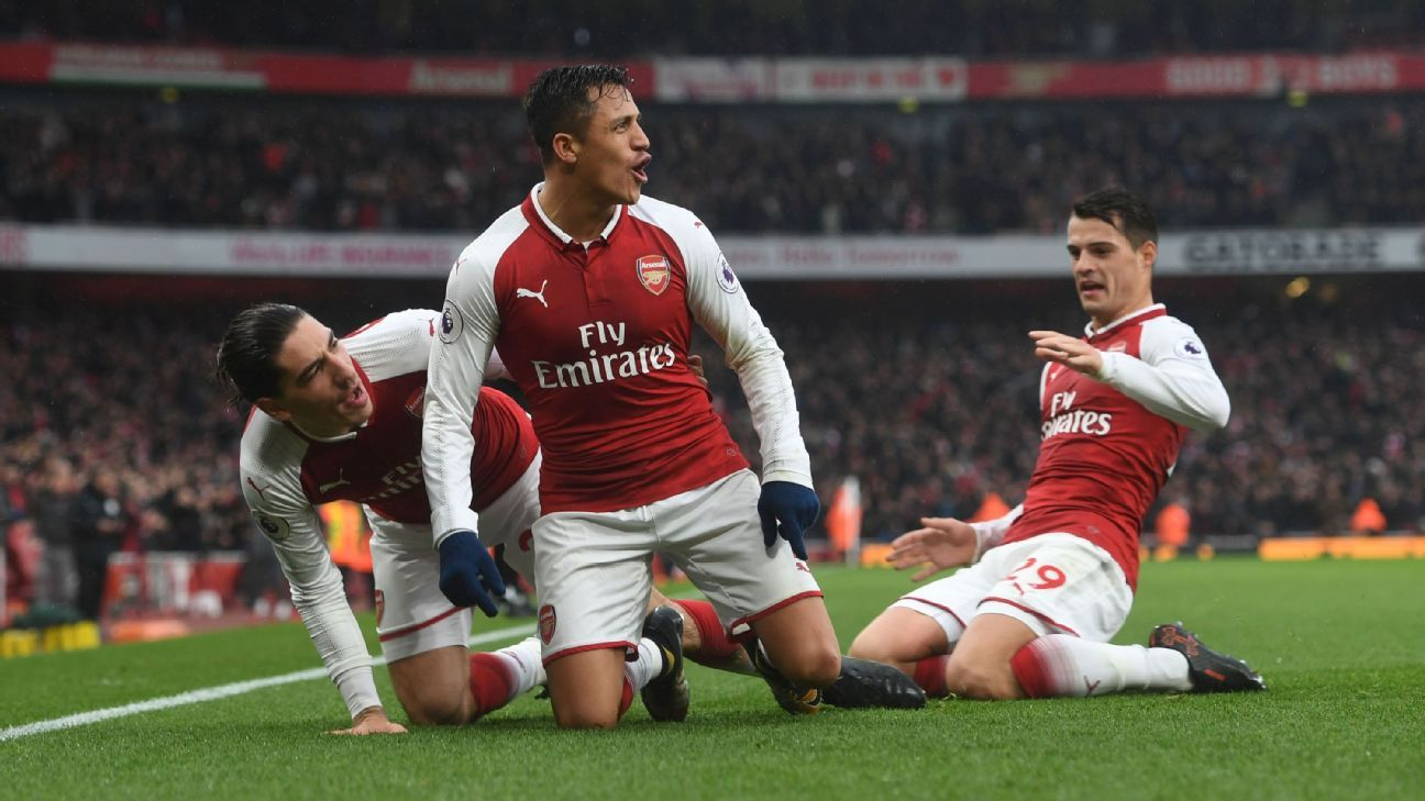 Alexis Sanchez celebrates scoring Arsenal's second goal against Tottenham Hotspur