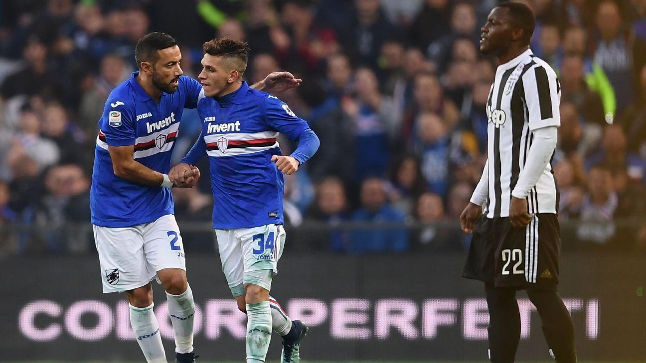 Sampdoria's Fabio Quagliarella celebrates with goal scorer Lucas Torreira against Juventus