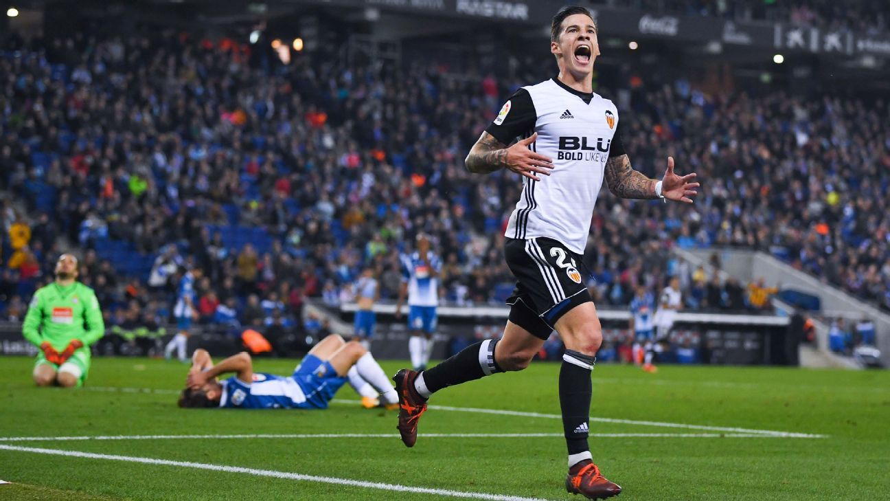 Santi Mina celebrates scoring Valencia's second goal at Espanyol.