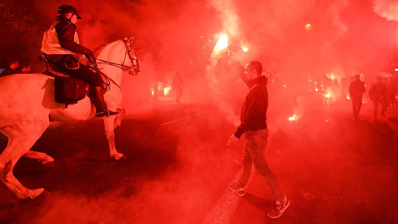 Fans light flairs ahead of the Sevilla clash with Liverpool in the Champions League.