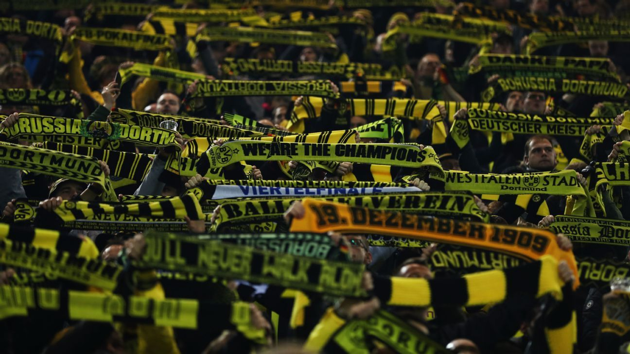 Fans of Borussia Dortmund hold up their ahead of their clash with Tottenham.