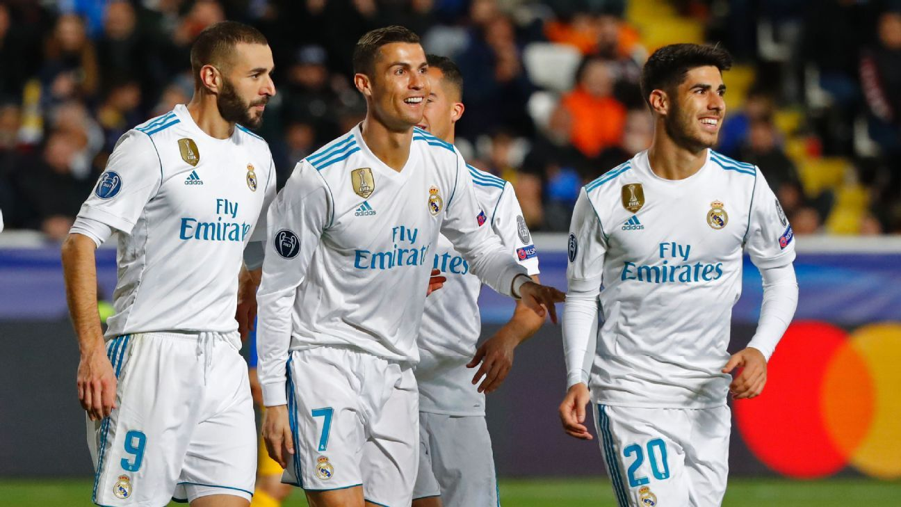 Cristiano Ronaldo celebrates with teammates after scoring a goal for Real Madrid against Apoel Nicosia.