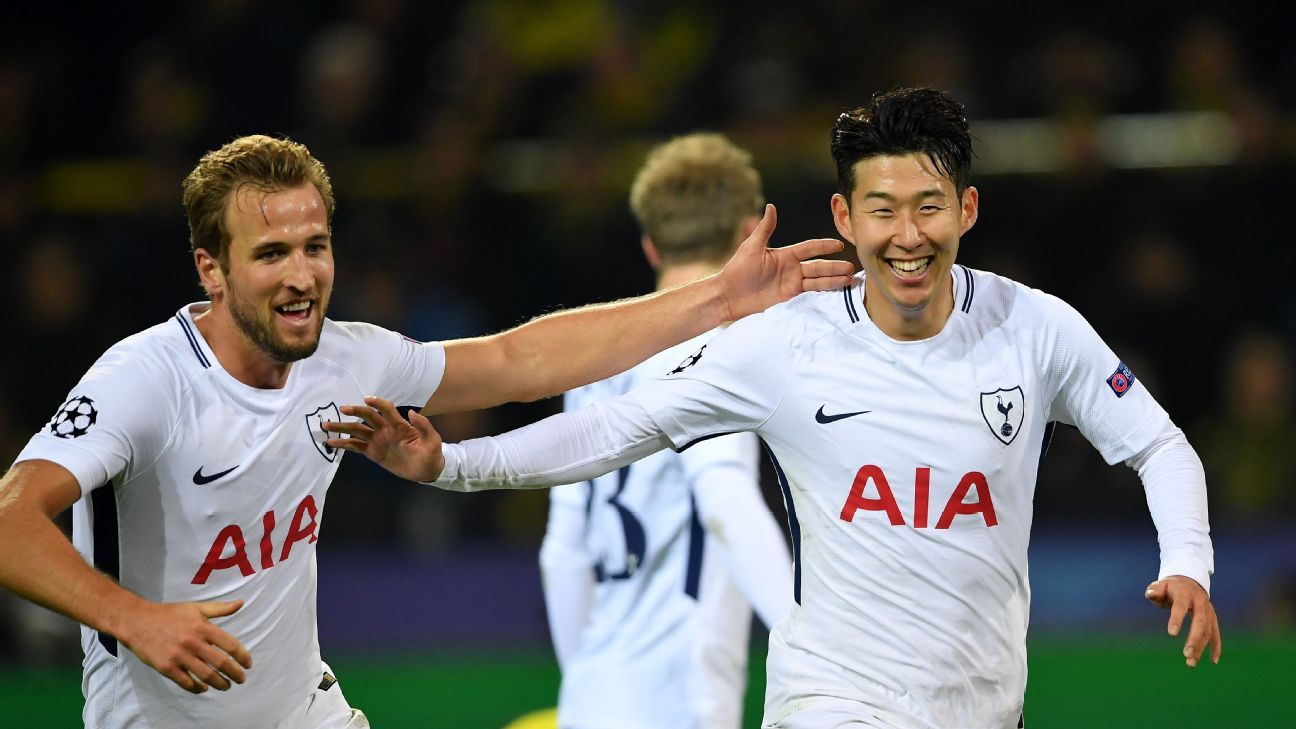 Son Heung-Min celebrates with Harry Kane after scoring Tottenham's winner.