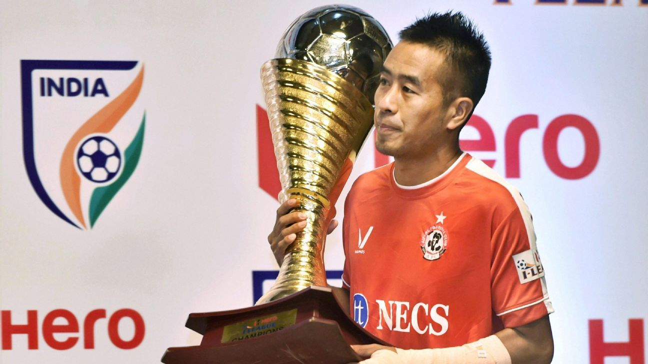 Aizawl FC's Shylo Malsawmtluanga with the I-League trophy at a press conference in New Delhi on Tuesday.