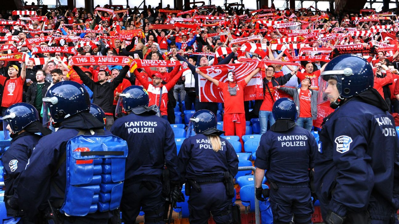Seville police monitor Liverpool fans during Champions League clash at Sevilla