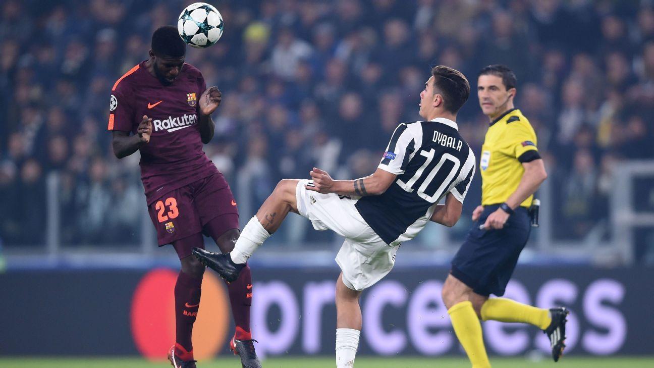 Juventus' Paulo Dybala vies with Barcelona's Samuel Umtiti in the Champions League.