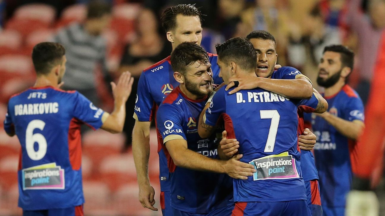 Newcastle Jets players congratulate Dimitri Petratos during their A-League win against Melbourne Victory.