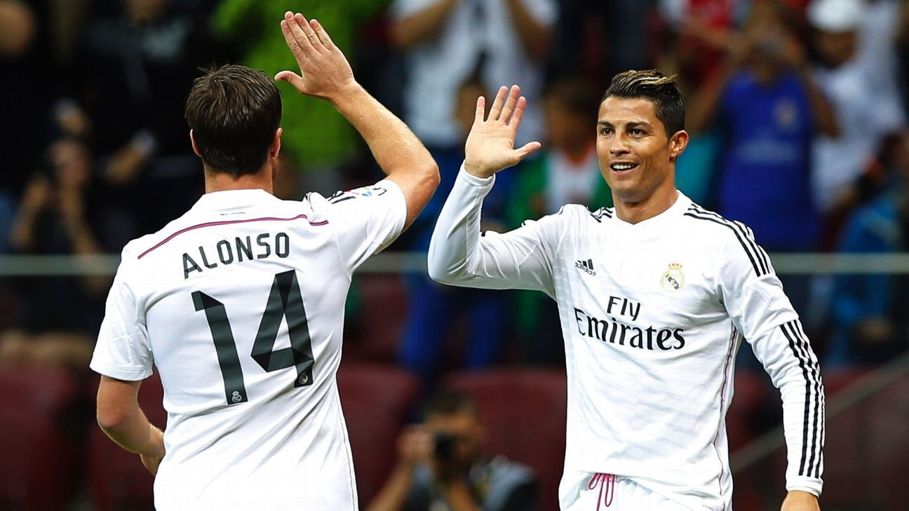 WARSAW, POLAND - AUGUST 16: Cristiano Ronaldo (R) and Xabi Alonso of Real Madrid CF celebrate after scoring during the mach Real Madrid and Fiorentina on August 16, 2014 in Warsaw, Poland. (Photo by Helios de la Rubia/Real Madrid via Getty Images)