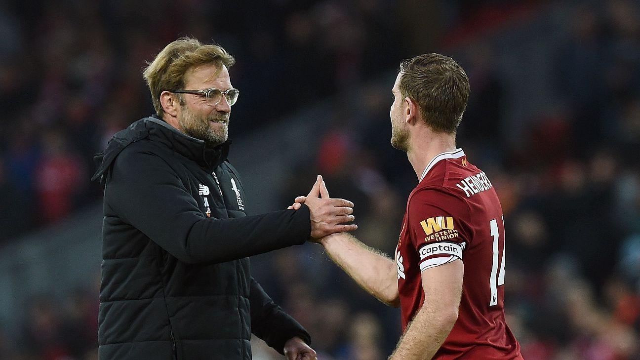 Jurgen Klopp and Jordan Henderson celebrate following Liverpool's Premier League match against Huddersfield.