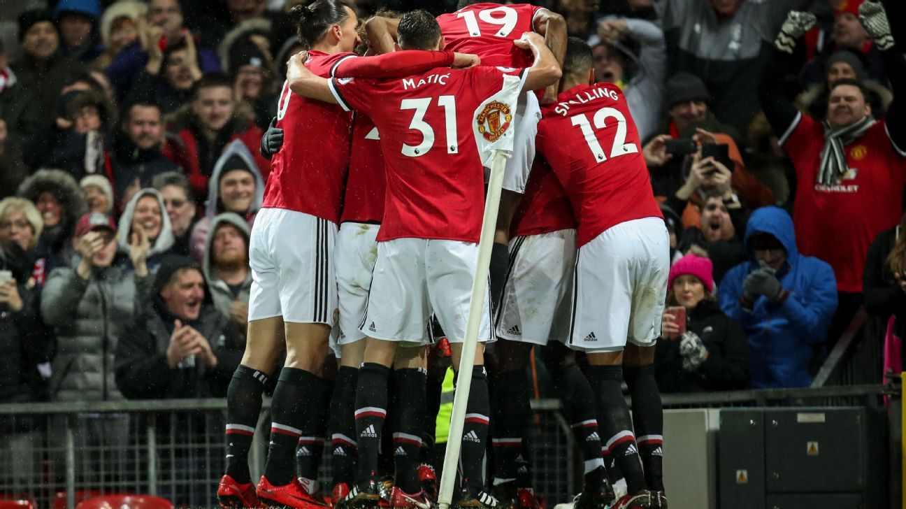 Manchester United celebrate after scoring against Brighton.