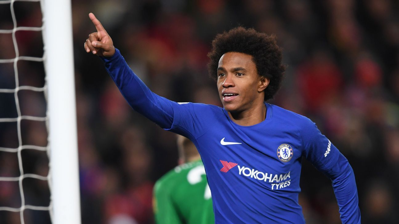 Willian celebrates his equaliser for Chelsea.