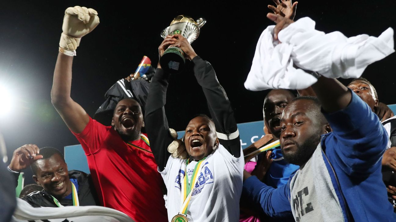 Rainford Kalaba celebrates with the trophy as TP Mazembe win the 2017 CAF Confederation Cup