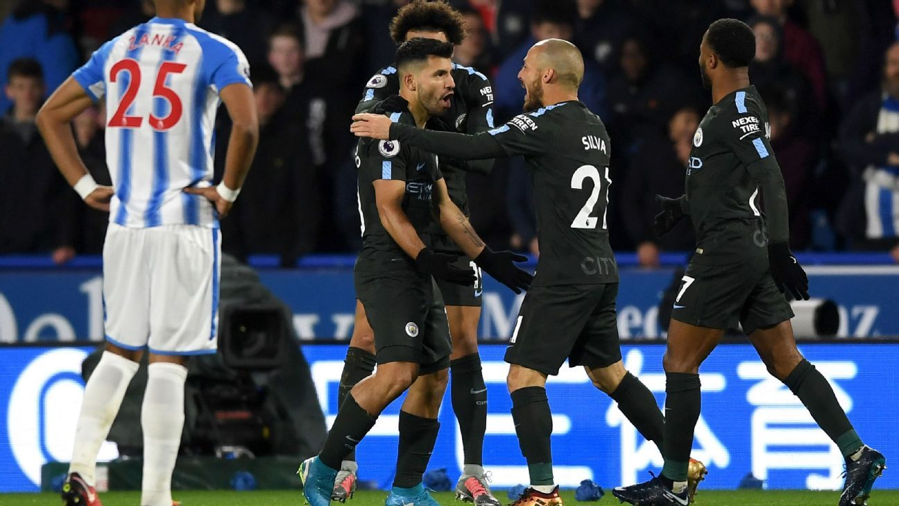 Sergio Aguero celebrates his goal for Manchester City against Huddersfield.