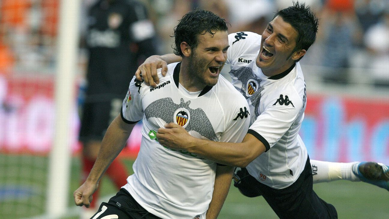 Juan Mata celebrates with Valencia teammate David Villa