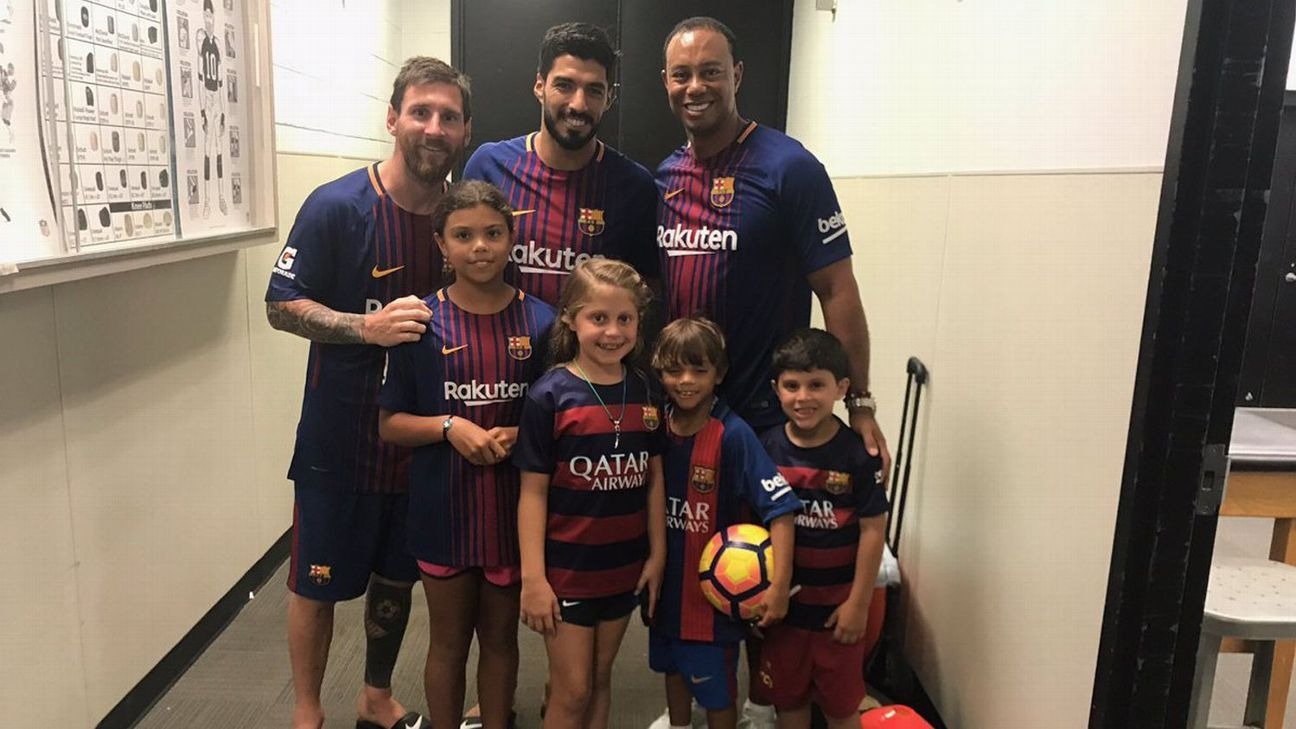 Tiger Woods and his children met Barcelona stars Lionel Messi and Luis Suarez in the summer