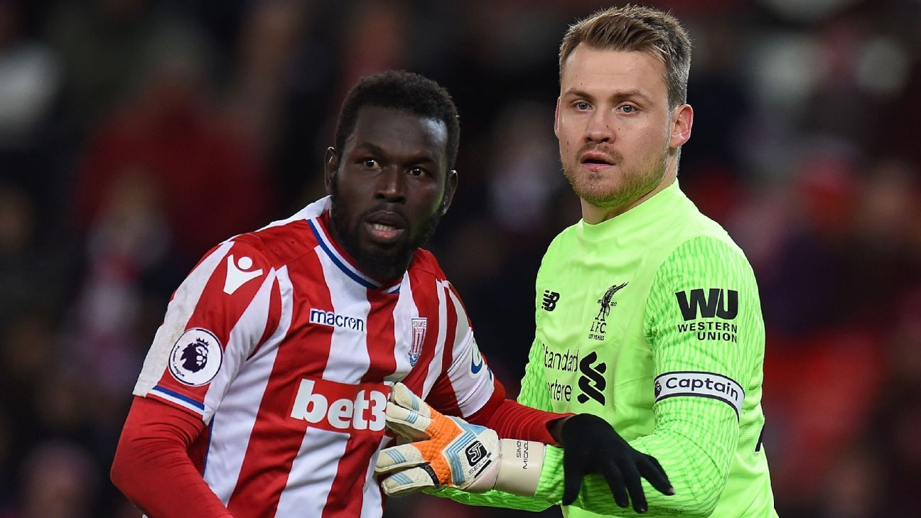 Stoke City's Mame Biram Diouf and Liverpool's Simon Mignolet