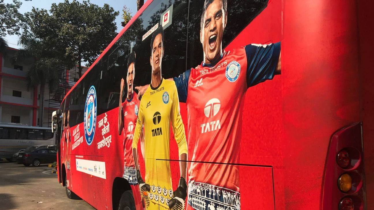 Subrata Pal (centre) had to wait outside the gates of the Tata football academy in order to give a trial for admission as a teenager, his image now features on the side of the team bus of Jamshedpur FC.
