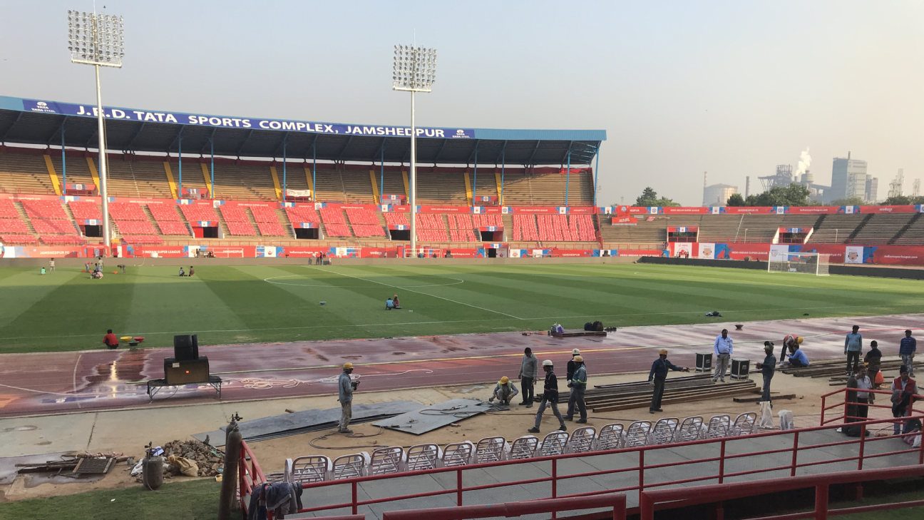 Last minute work gets the stadium ready in time for Friday's 8pm kickoff. In the distance, the smokestacks of the Tata steel plant can be seen. The steel mill is the core of Jamshedpur's existence.