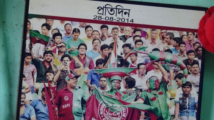 Bapi Maji, bottom left, wearing a Bagan T-shirt with his name emblazoned on it, during Mohun Bagan's 2014-15 I-League-winning campaign.