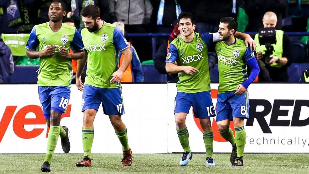 Seattle celebrates scoring a goal against the Houston Dynamo in the MLS playoffs.