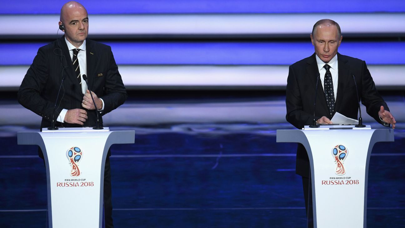 Gianni Infantino, left, and Vladimir Putin, right, at the 2018 FIFA World Cup draw in Moscow.