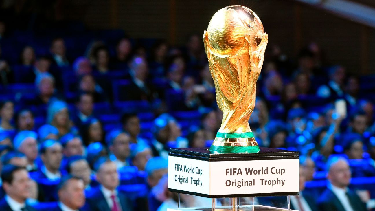 The World Cup trophy is displayed on stage at the 2018 draw
