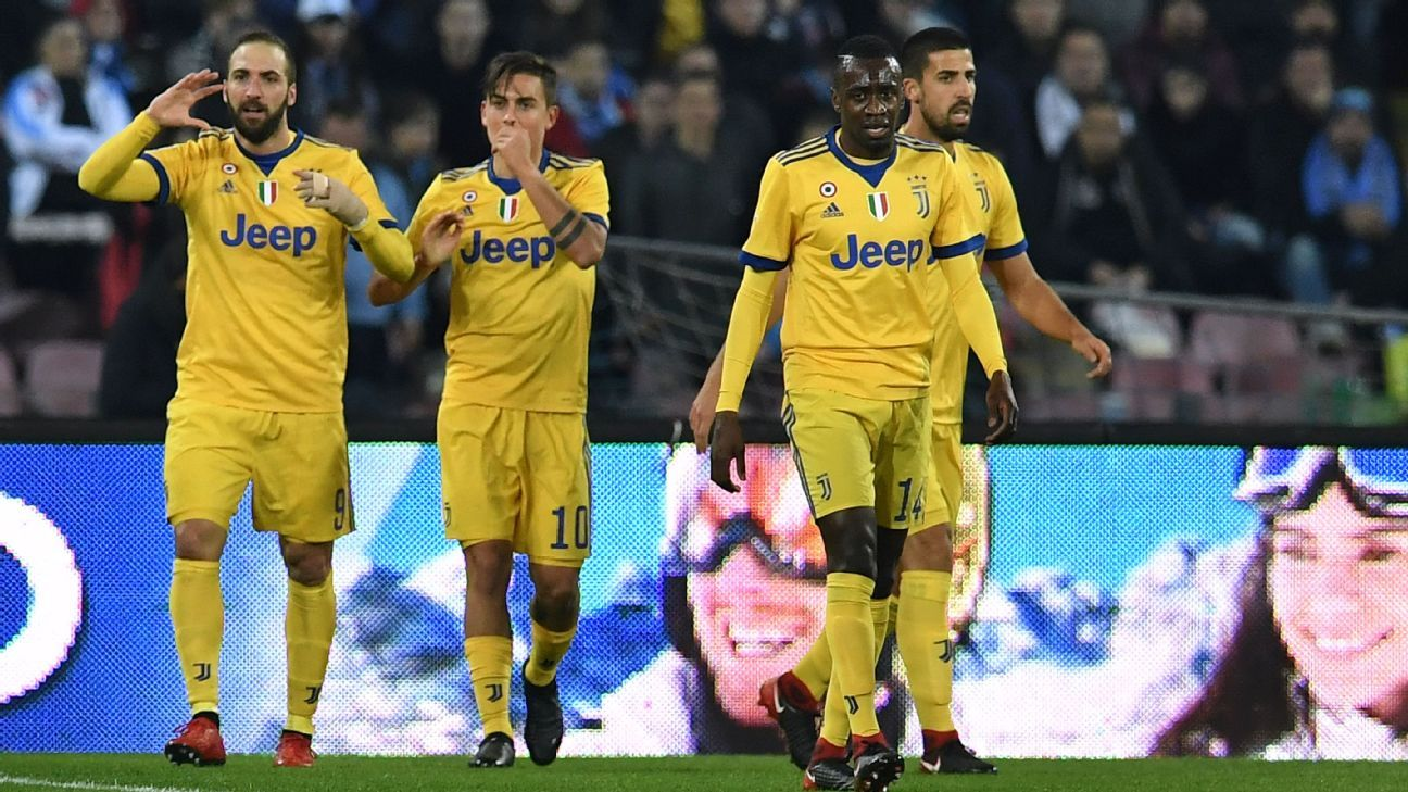 Juventus players celebrate after scoring a goal against Napoli.