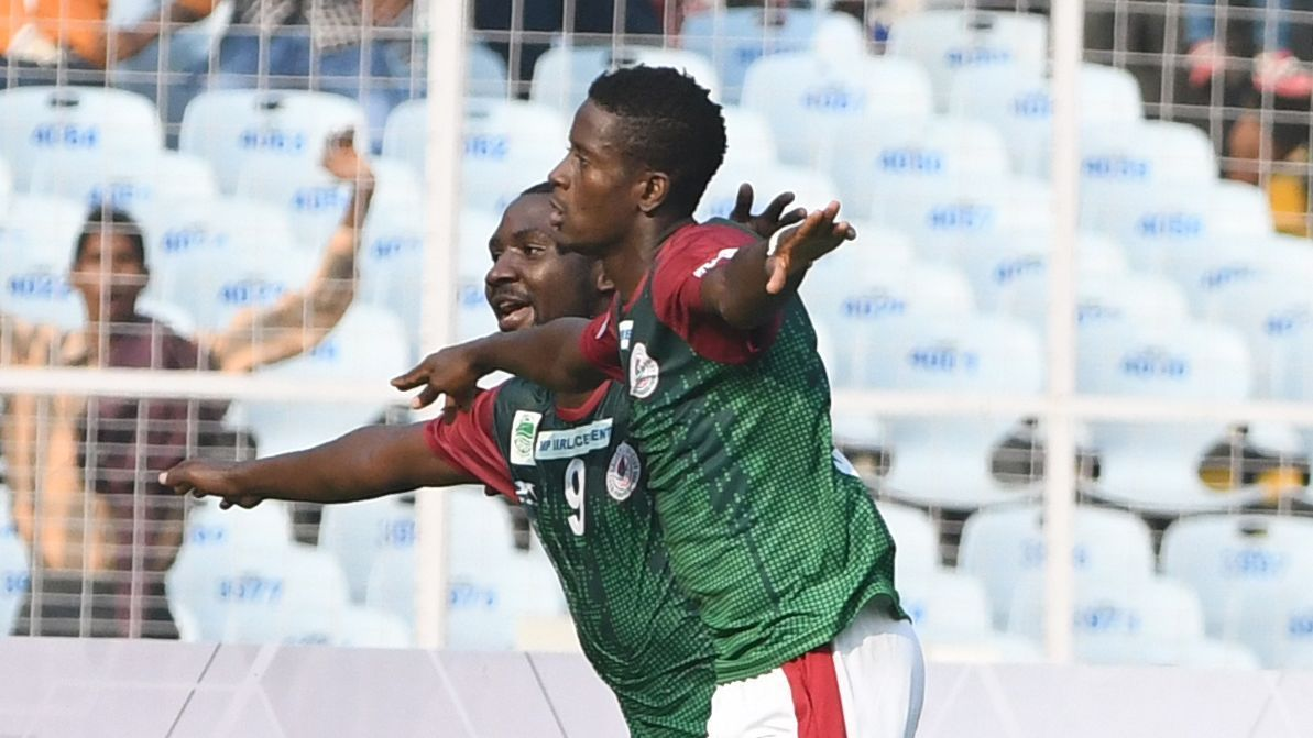 Kingsley Obumneme (R) and Dipanda Dicka celebrate Mohun Bagan's goal vs East Bengal.