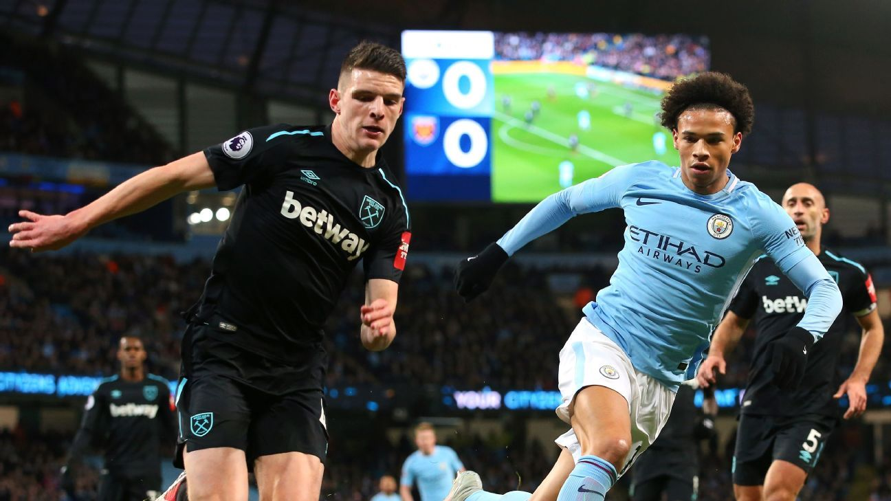 West Ham United's Declan Rice takes on Leroy Sane of Manchester City