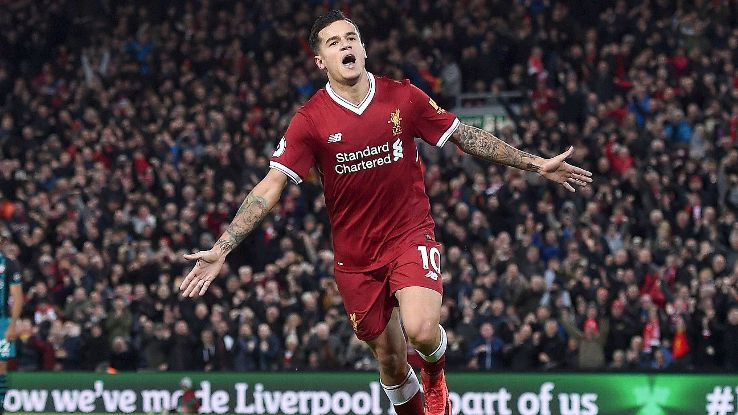 Philippe Coutinho celebrates after scoring one of his three goals on the evening.