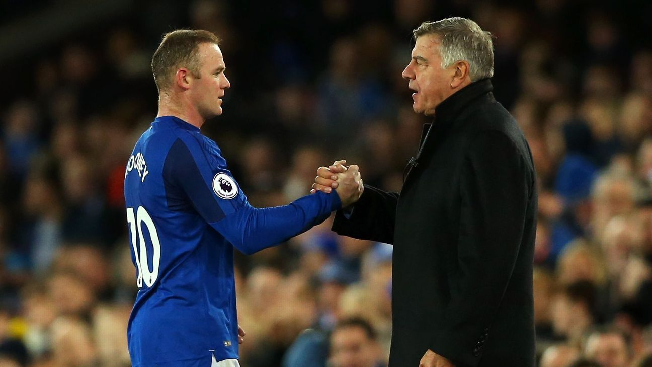 Wayne Rooney, left, and Sam Allardyce shake hands after Everton's match against Huddersfield Town.