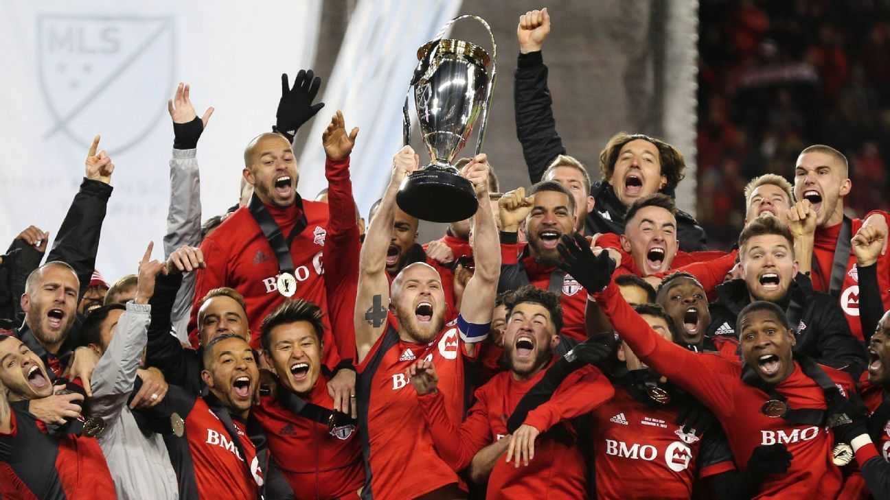 Toronto FC capped a treble season with an MLS Cup trophy after beating Seattle 2-0.