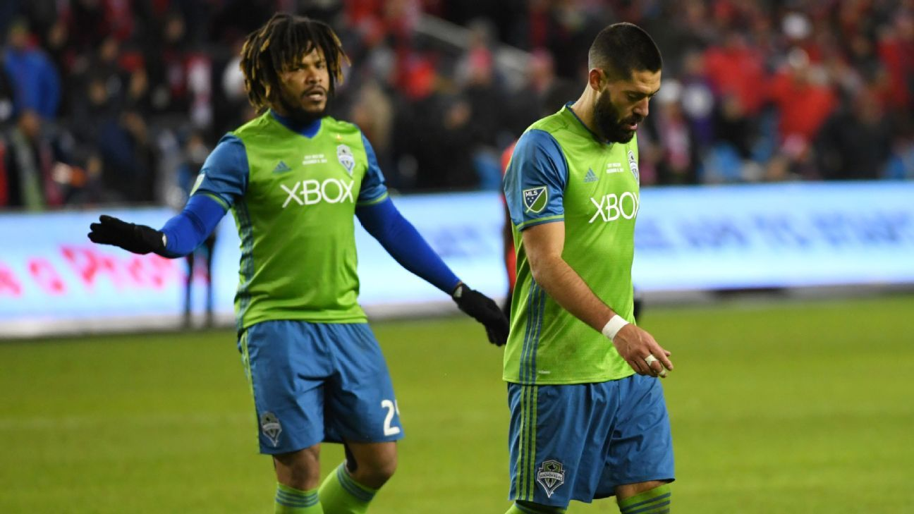 Roman Torres and Clint Dempsey