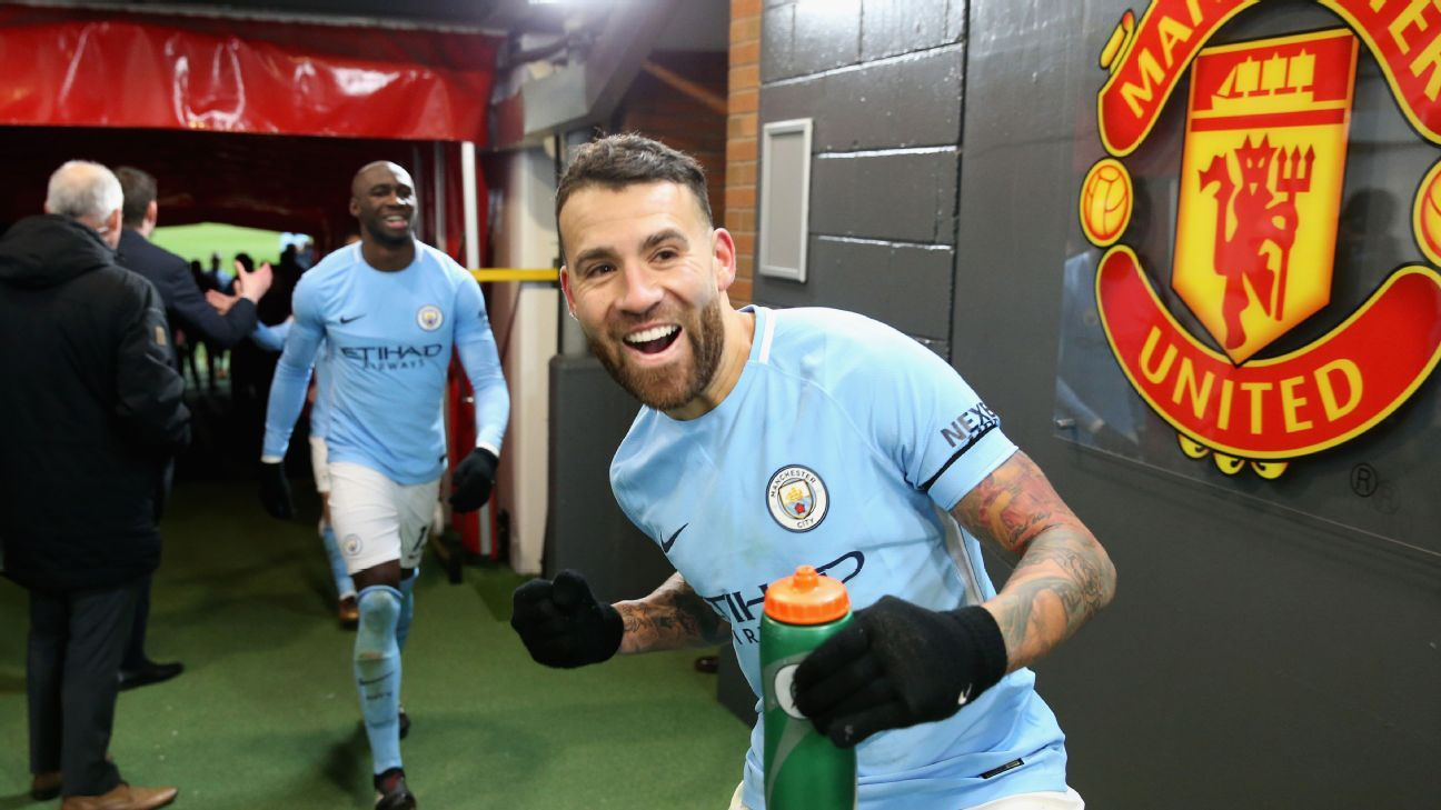 Nicolas Otamendi celebrates after Manchester City's defeat of Manchester United at Old Trafford.