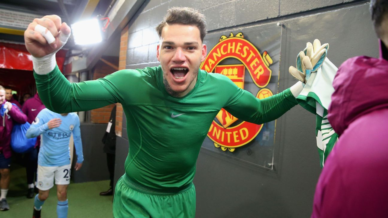 Ederson celebrates Manchester City's victory over Manchester United.