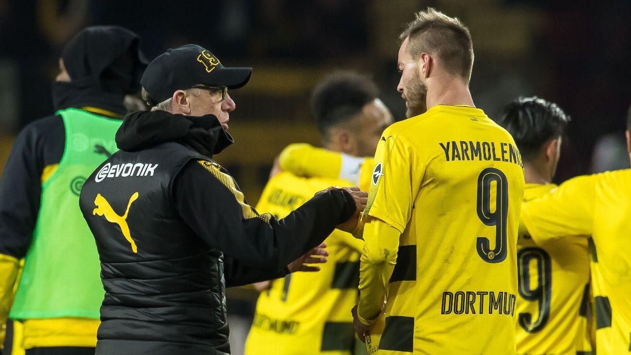 Borussia Dortmund manager Peter Stoger speaks with Andrey Yarmolenko after a Bundesliga win against Mainz.