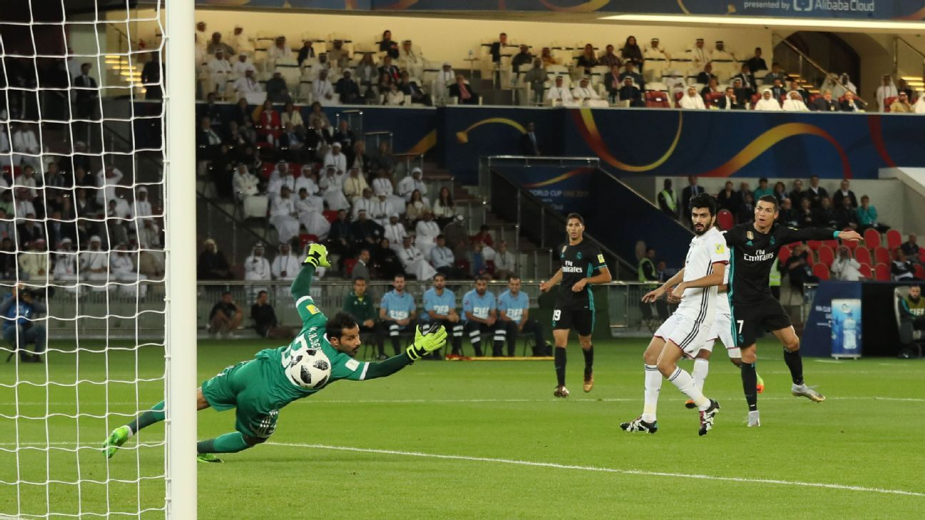 Cristiano Ronaldo scores for Real Madrid in their Club World Cup game against Al Jazira.