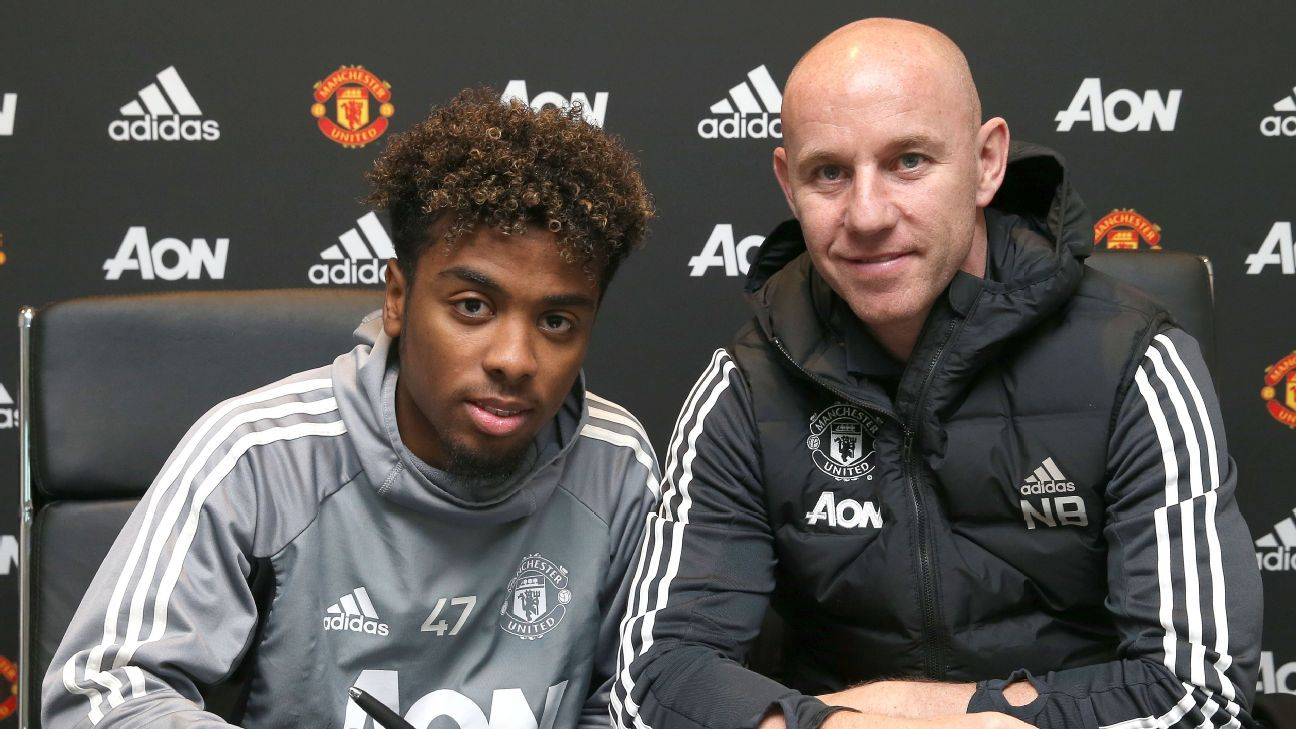 Angel Gomes signs his first professional contract with Manchester United.
