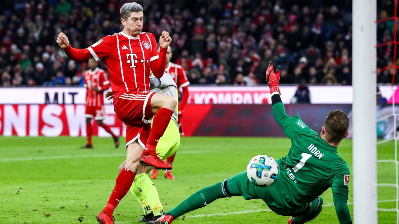 Robert Lewandowski scores for Bayern Munich in their Bundesliga game against Cologne.