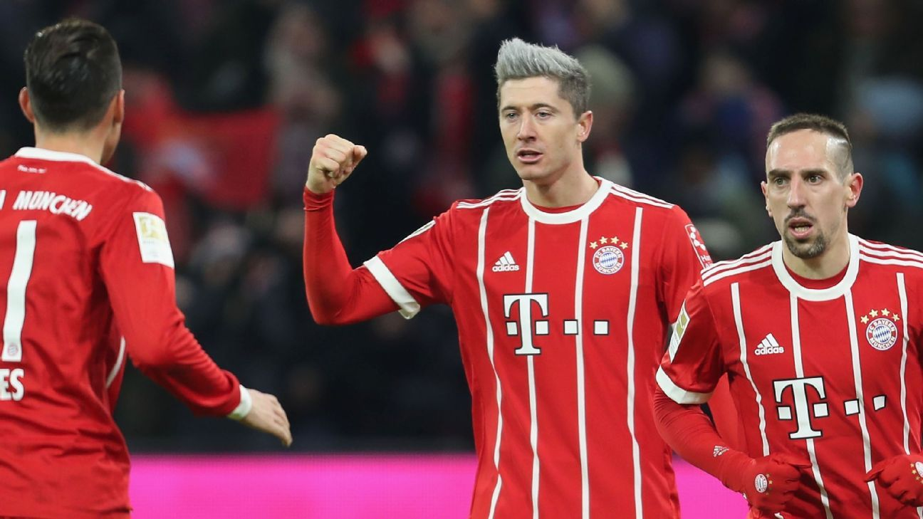 Robert Lewandowski celebrates after scoring for Bayern Munich against Cologne.