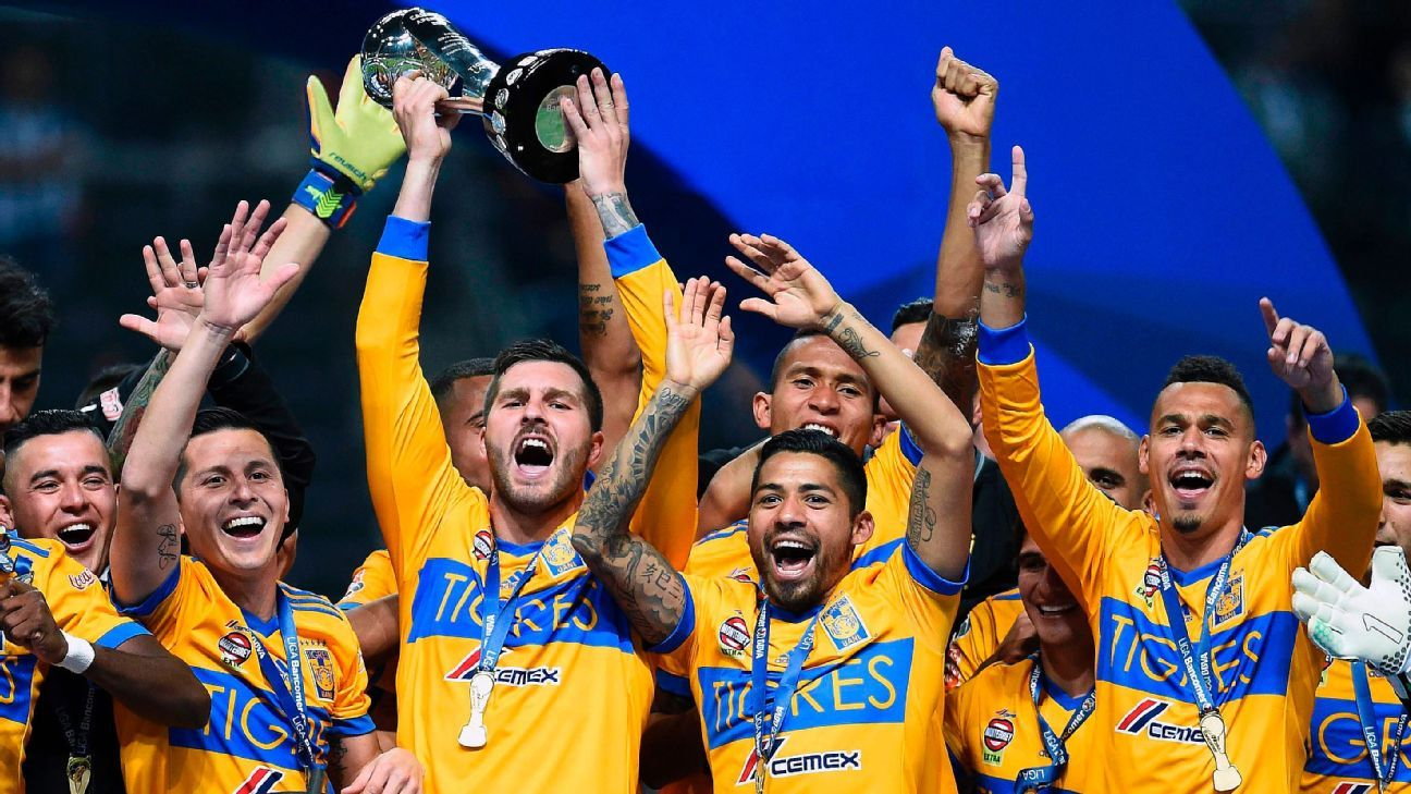 Tigres celebrate their 2017 Apertura title win over Monterrey.