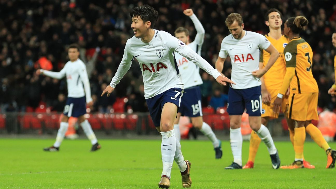 Son Heung-Min celebrates after scoring a goal for Tottenham against Brighton.