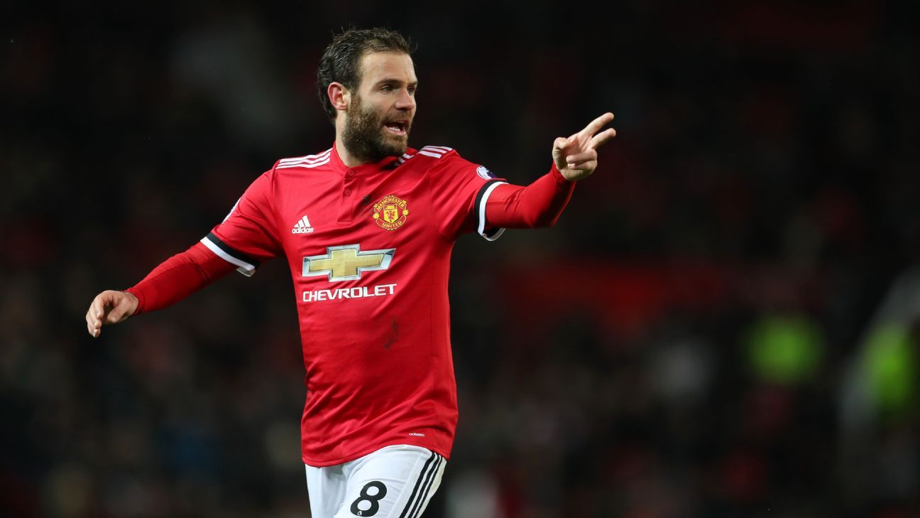 Juan Mata gestures to Man United teammates during a match against Bournemouth.