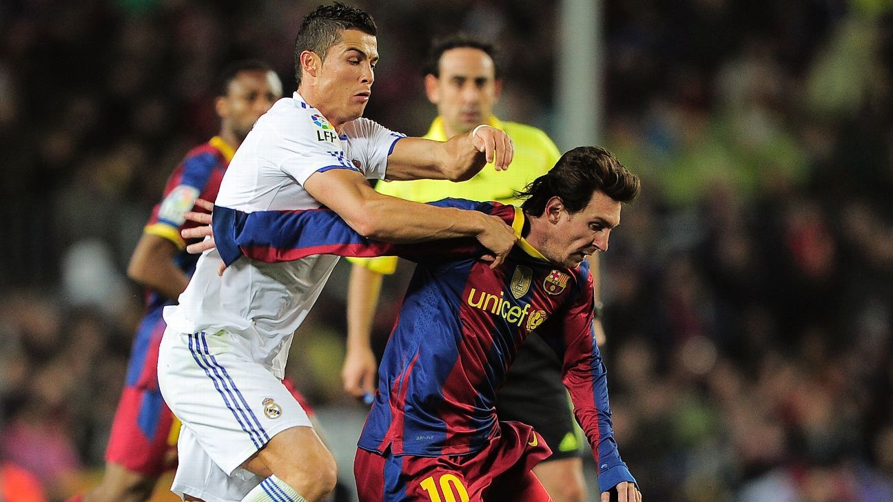 Lionel Messi and Cristiano Ronaldo battle for ball during Barcelona's 5-0 win over Real Madrid in 2010