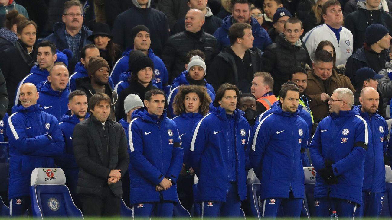David Luiz sits behind manager Antonio Conte before Chelsea's match against Swansea.